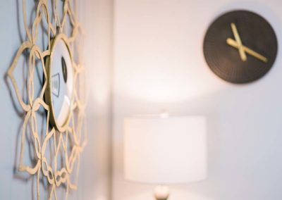 Mirror wall decor and clock in a new office