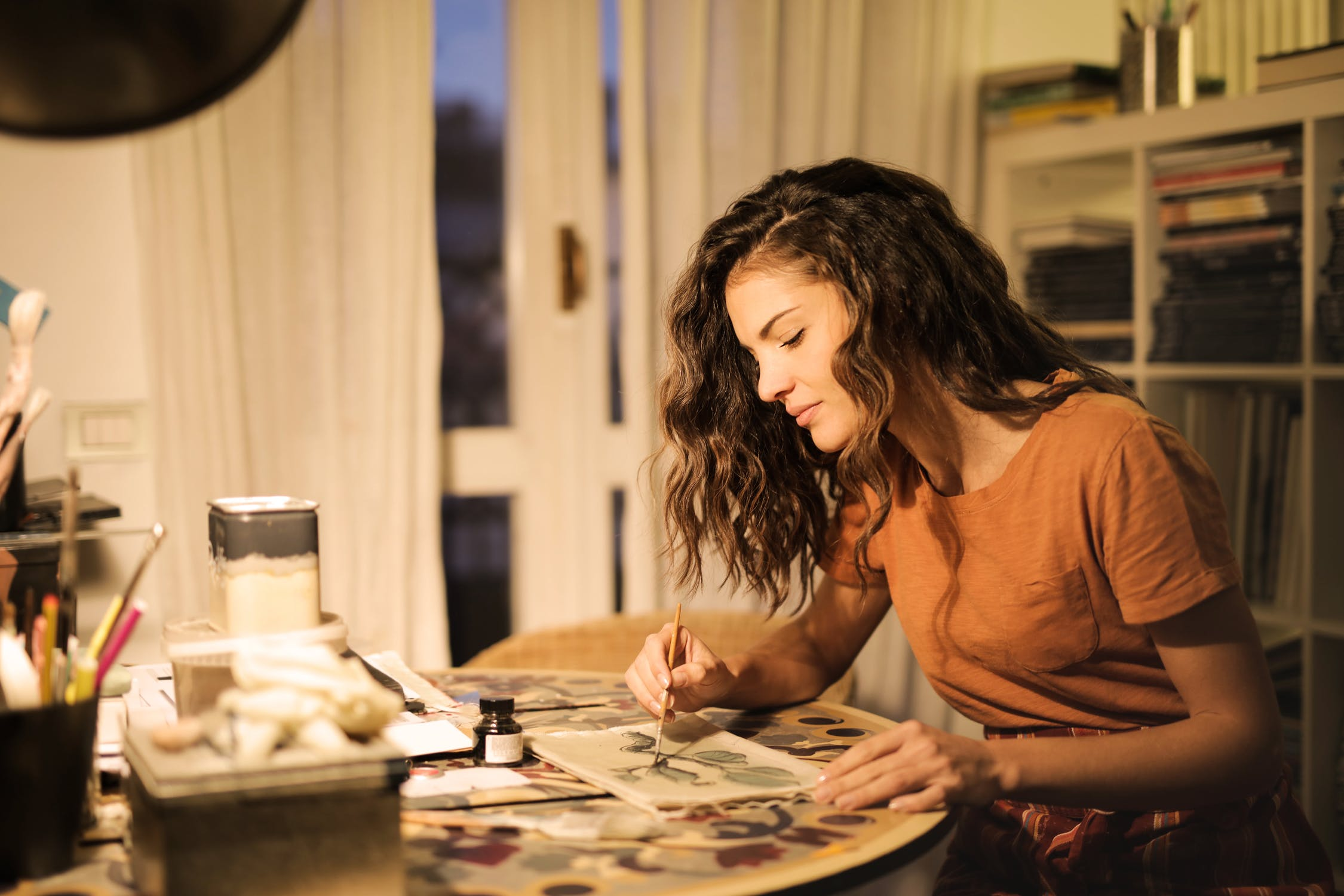 woman painting looking content